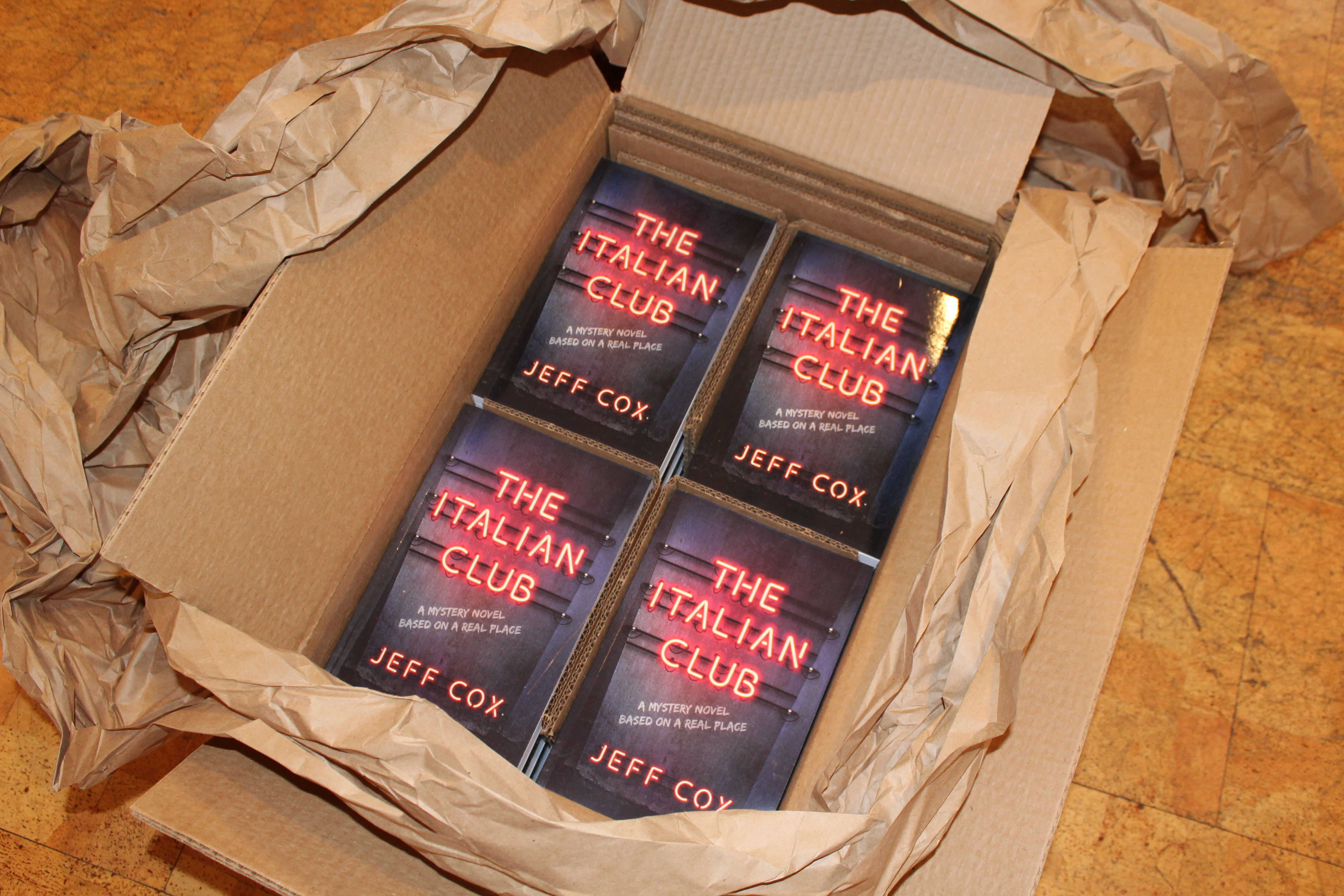 A case of copies of the new novel, The Italian Club, by Jeff Cox